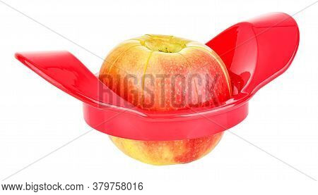 Cutting Of Ripe Colorful Apple By Apple Cutter Isolated On White Background