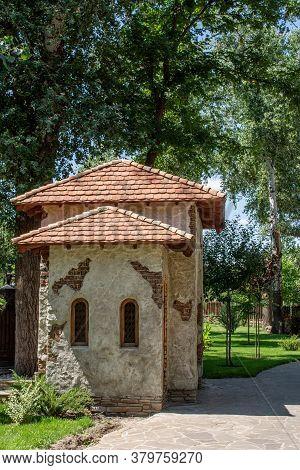 Old Mediterranean Stone House In Green Garden. Mediterranean Style Decoration Of A Garden.