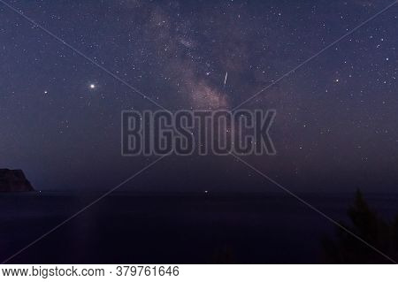 The Milky Way Over The Sea. Beautiful Starry Sky. Watching Shooting Stars. The Path Of The Celestial