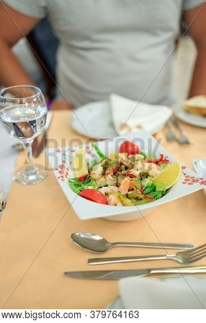 Turkish Style Salad With Shrimps, Gherkins And Vegetables On A Plate. Serving In A Turkish Restauran