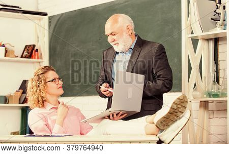 Communicate Clearly And Effectively. Man Mature School Teacher And Carefree Girl Student With Laptop