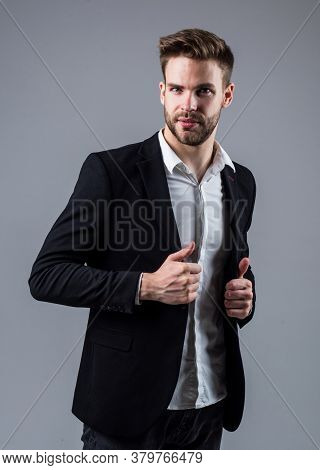 Businessman In Suit. Young Handsome Man. Young Manager In His Office. Portrait Of A Businessman On G