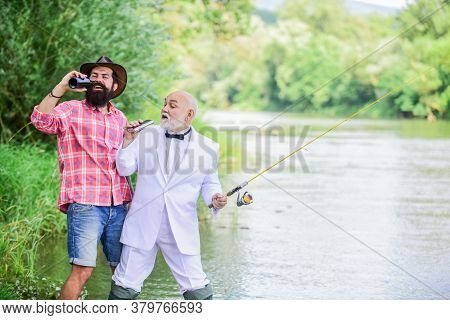Cheers. Two Fishermen With Fishing Rods. Retired Businessman. Male Friendship. Summer Family Weekend