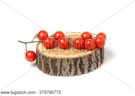 Cherry tomatoes on wood slice, isolated on white.