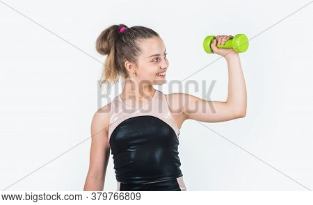 Show Strength. Small Girl Training With Barbells. Sport And Fitness. Teen Girl Hold Dumbbell. Sports