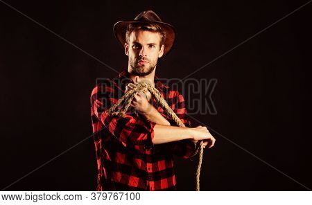 Sheriff. Wild West Rodeo. Man In Hat Black Background. Western Cowboy Portrait. Cowboy With Lasso Ro
