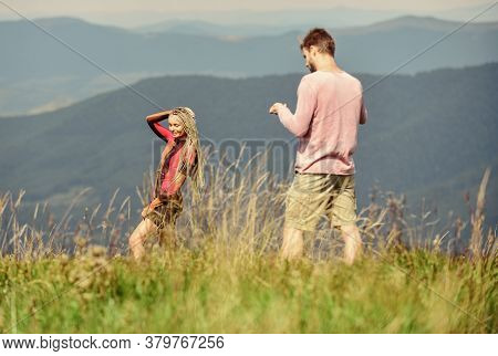 Snapping Memories. Man And Woman Posing Mobile Photo. Lets Take Photo. Summer Vacation Concept. One