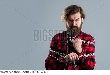 Very Tight. Conceptual Symbol Of Freedom. Male Fashion. Strong Man With Chains. Problem Solving. Man