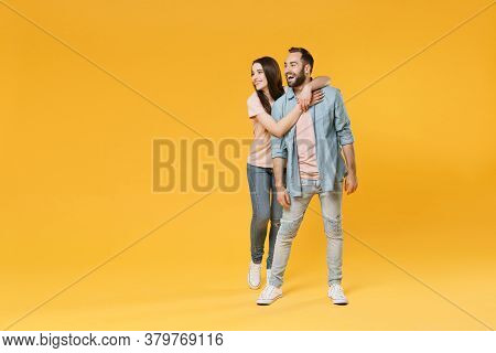 Cheerful Young Couple Two Friends Guy Girl In Pastel Blue Casual Clothes Posing Isolated On Yellow B