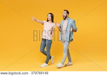 Excited Young Couple Two Friends Guy Girl In Pastel Blue Casual Clothes Posing Isolated On Yellow Ba