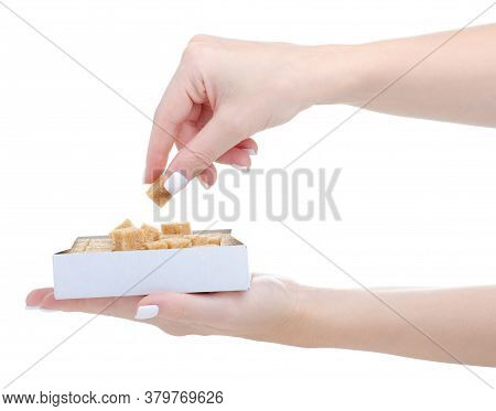 Hand Holding Cane Brown Sugar Cubes In Package On White Background Isolation
