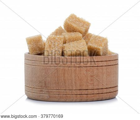 Wooden Bowl With Cane Brown Sugar Cubes On White Background Isolation