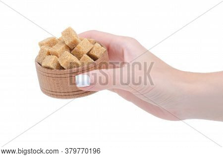 Wooden Bowl With Cane Brown Sugar Cubes In Hand On White Background Isolation