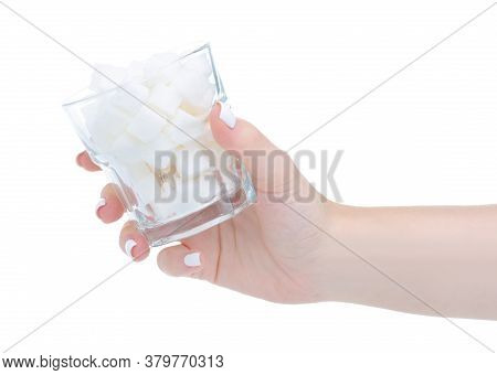 Glass With White Sugar Cubes In Hand On White Background Isolation