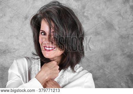 Portrait Of A Beautiful Mature Woman Wearing A White Robe
