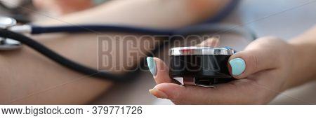 Female Hand Measures Pressure Patient In Clinic. Quality Treatment At Diagnostic Center. Consultatio