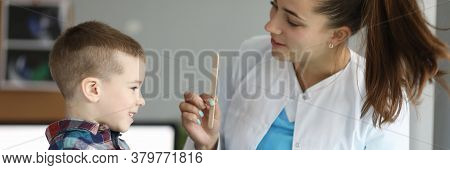 Child Doctors Appointment, Plays With Stethoscope. Family Doctor Helps Child Cope With Fear Being Ex