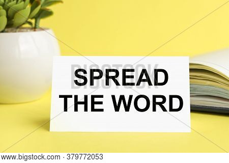 Spread The Word. Text On White Paper On Yellow Background Near Diary And Flowerpot