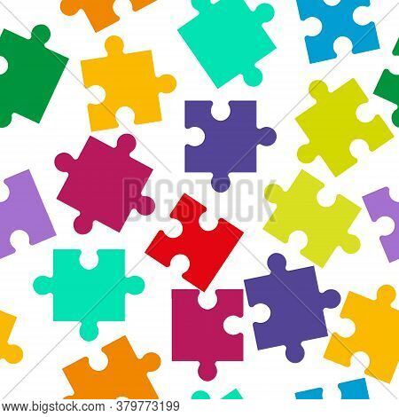 Seamless Pattern Of Colored Puzzle Pieces For Texture, Textiles And Simple Backgrounds.