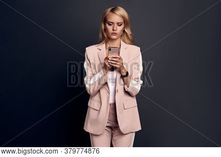 Displeased Upset Female Curves Lip, Being Unhappy To Receive Bill From Banking Service On Mobile Pho