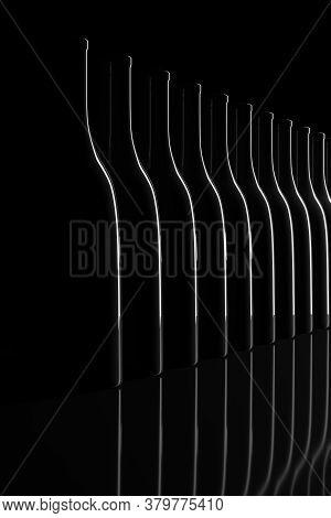 Row Of Backlit Bottles On Black Background. 3d Illustration.