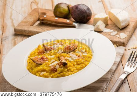 milanese risotto with cheese fig and sliced almond