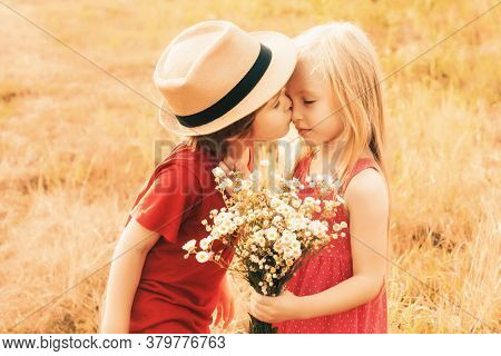 Happy Lovely Kids Kiss On Autumn Field. Cute Little Children Kissing And Enjoying At Countryside. Lo
