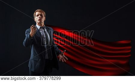 Red-cloaked Superhero Gives A Rousing Speech, A Young Man In A Suit And Tie Gives An Inspirational S