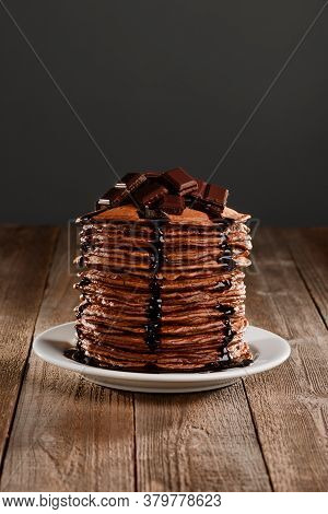 Pile Of Pancakes With Melting Chocolate Pieces On Top