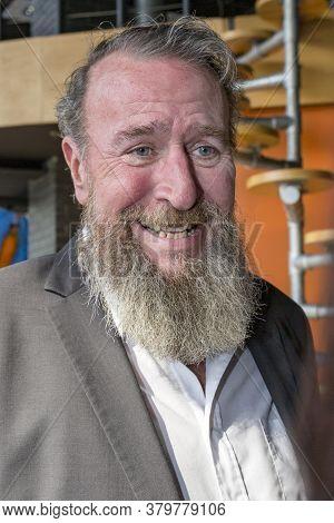 08.03.2019 Kiev Ukraine Portrait Of An Impressive Elderly Man With A Beard Who Is Smiling. Grandfath