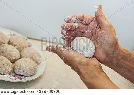Homemade Meatballs - Female Hands Make Minced Meatballs - Traditional Italian Cuisine
