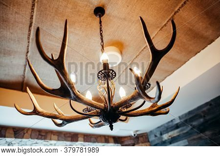 Chandelier Made Of Antlers, The Chalet-style Design Chandelier Interior Of The Cafe