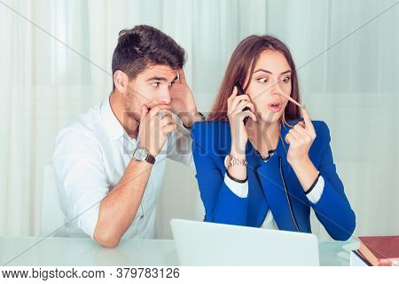 Young Nosy Man Eavesdropping On Young Woman Telling Lies While Speaking On Phone, Girl Surprised By