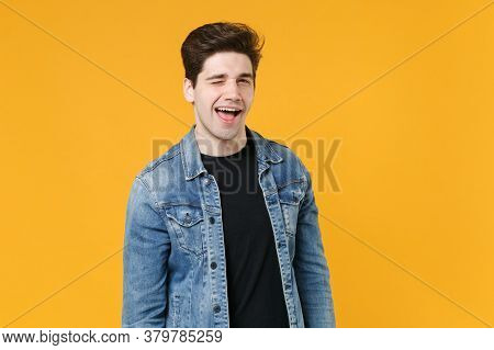 Cheerful Funny Young Man Guy Wearing Casual Denim Jacket Posing Isolated On Yellow Background Studio