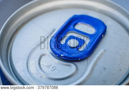 Closed Soda Can With Blue Opener, Macro Of Lid