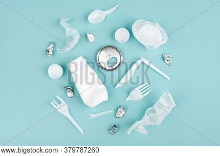 Plastic Waste Collection On Blue Background. Concept Of Recycling Plastic And Ecology.