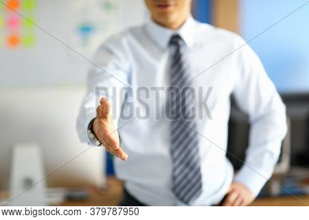 White Collar Worker Showing His Respect To Corporate Lifestyle By Offering Handshake To Guest And Po