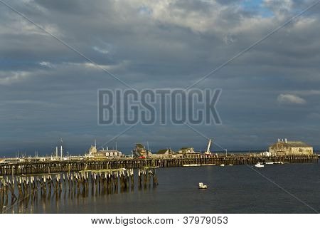 Dock And Pier At Sunset
