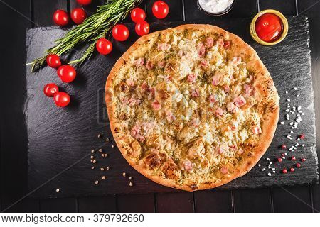 Traditional Italian Focaccia Among Tomato And On A Dark Background, Studio Light. Traditional Food C