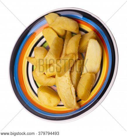 Fried Potato Wedges On White Black Red Yellow Plate. Fried Potato Veggies Isolated On White Backgrou