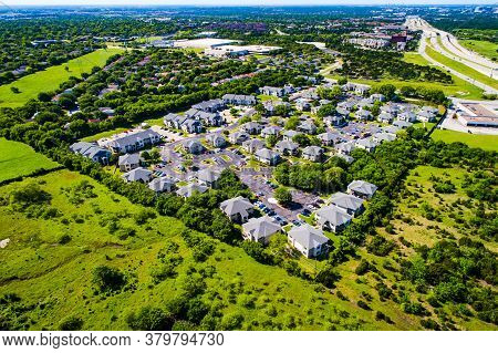 Large Plot Of Land Covered With Small Houses And Homes In New Development Aerial Drone View Above Gr