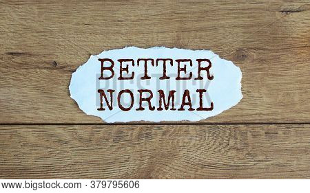 Words 'better Normal' On The Piece Of Paper. Wood Table. Business Concept.
