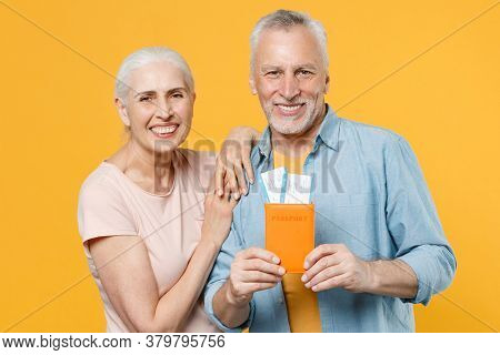 Smiling Elderly Gray-haired Couple Woman Man In Casual Clothes Isolated On Yellow Background. Passen