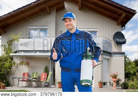 Pest Control Exterminator Man Worker In Front Of The Home