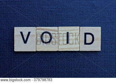 Gray Word Void From Small Wooden Letters On A Black Table