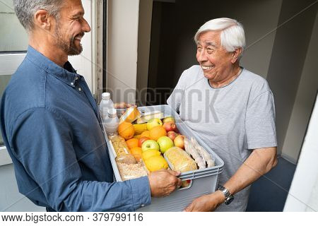 Grocery Food Shopping Help For Elder Senior Standing At Door