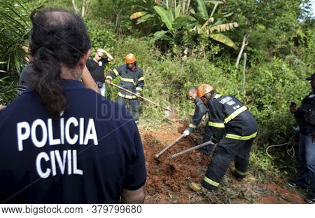 Salvador, Bahia / Brazil - August 24, 2015: Civil Police Investigators Are Investigating A Person Mu
