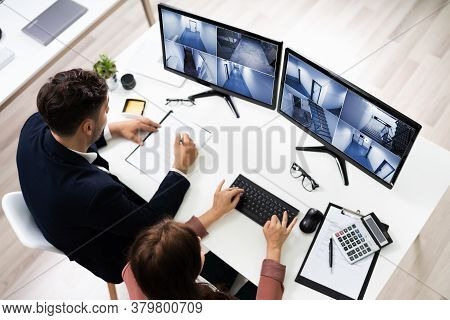 Cctv Footage Security Control Operators Watching Surveillance Footage On Computer