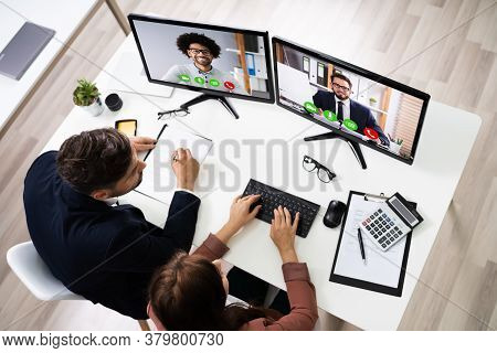 Happy Business People Using Elearning Videoconference On Computer In Office