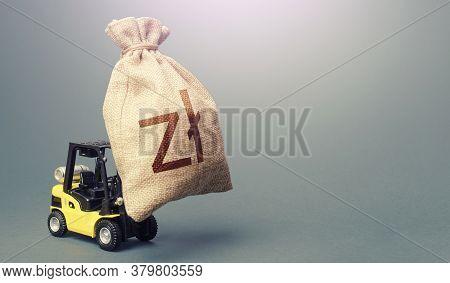 Forklift Carrying A Polish Zloty Money Bag. Anti-crisis Budget. Borrowing On Capital Market. Stimula